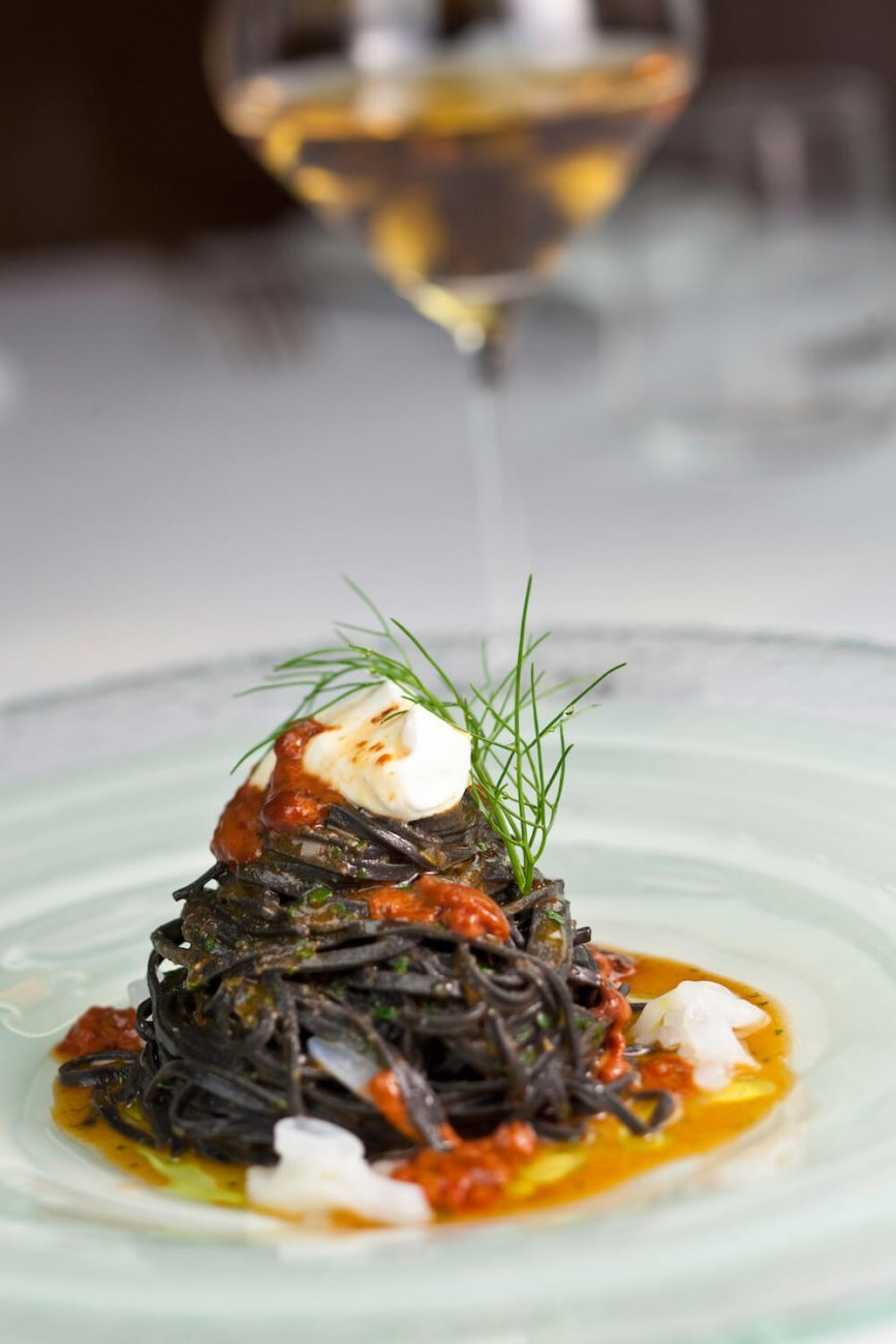 HOMEMADE BLACK SPAGHETTI WITH SEA URCHINS, RICOTTA CHEESE AND CUTTLEFISH