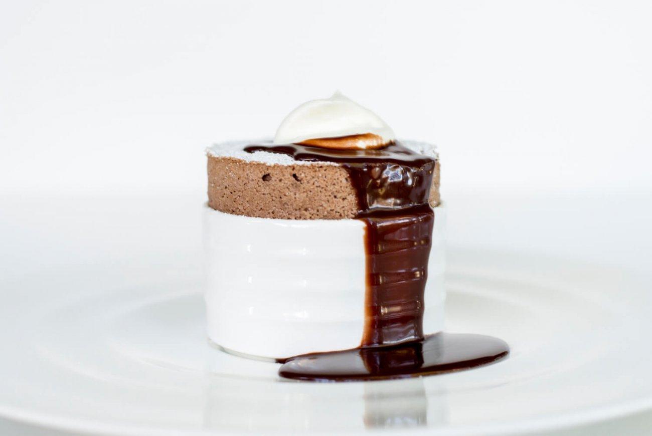 VALRHONA CŒUR DE GUANAJA CHOCOLATE SOUFFLÉ WITH BITTER CHOCOLATE SAUCE & WHIPPED CREAM