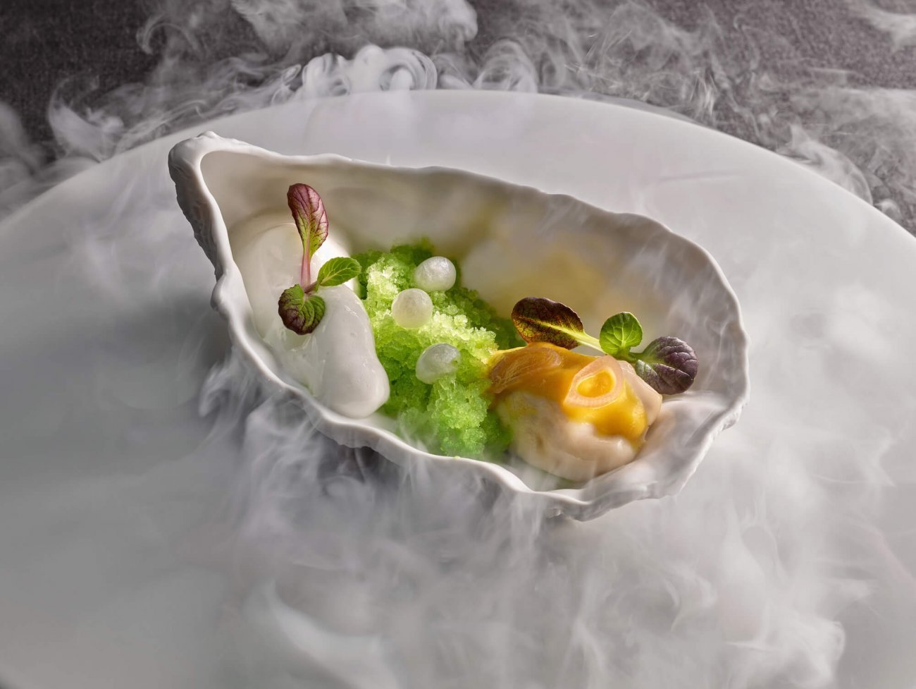 WARM PICKLED OYSTER WITH ICED CUCUMBER, K5 TXAKOLI WINE AND SPICY APPLE FOAM