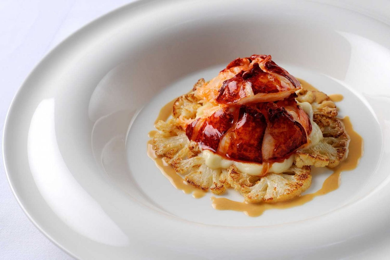 POACHED LOBSTER TAIL WITH CAULIFLOWER AND LOBSTER BUTTER SAUCE