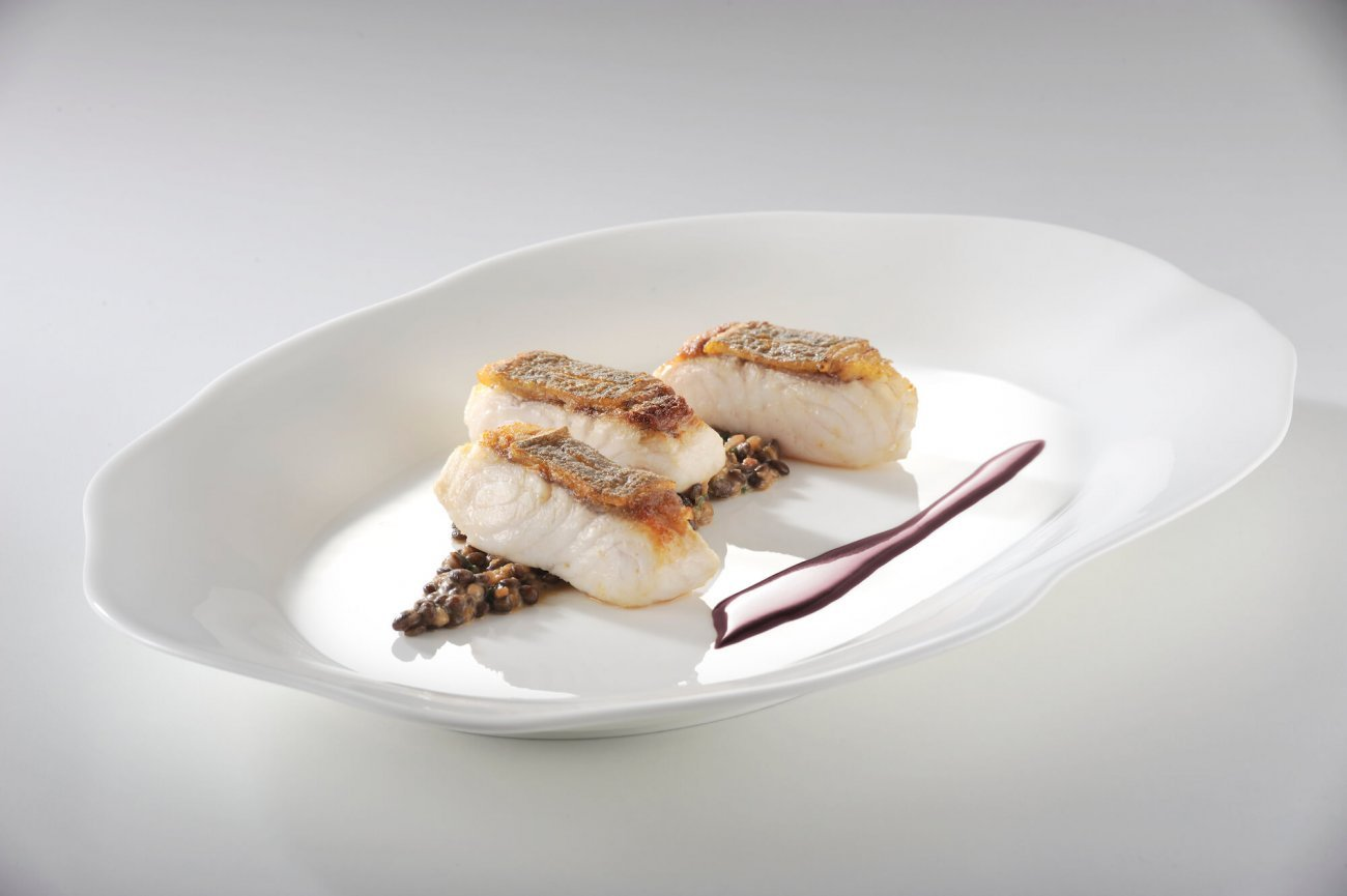 SHEATFISH MEDALLIONS SERVED WITH DIJON LENTILS AND RIOJA BUTTER