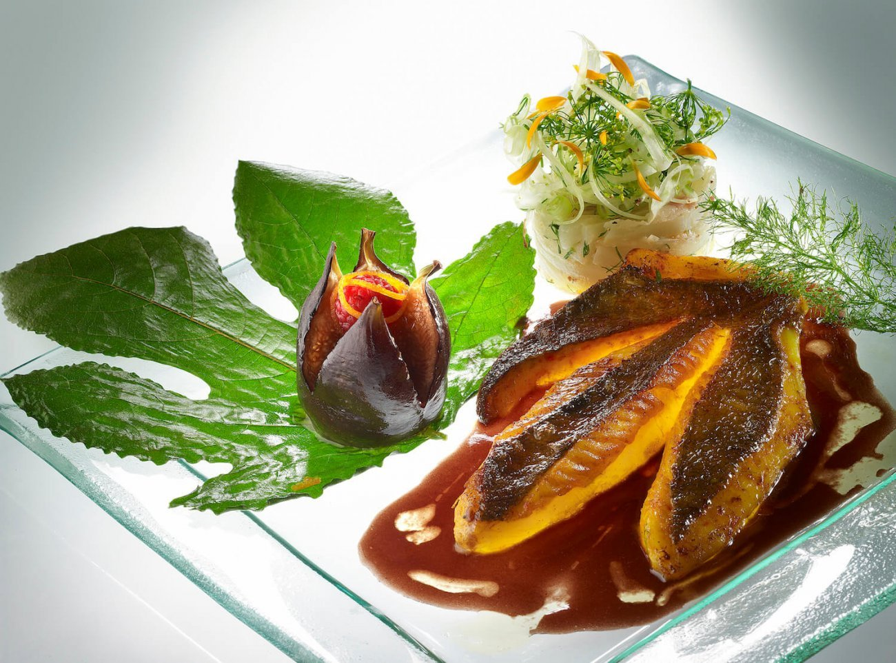 SAFFRON FILLET OF JOHN DORY ROASTED WITH FRESH FIGS, RED BANDOL WINE SAUCE AND ROSEMARY