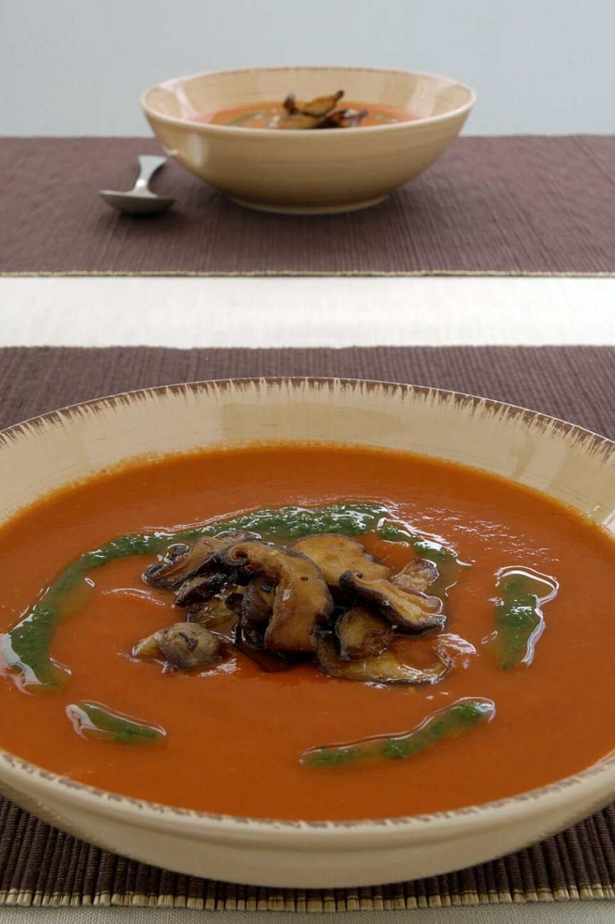 ROAST PEPPER SOUP WITH GARLIC SHITAKES AND PARSLEY OIL.