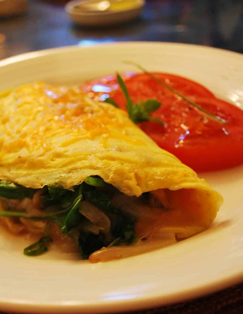 FRESH EGG OMELETTE WITH SWEET ONION MARMALADE & SPINACH