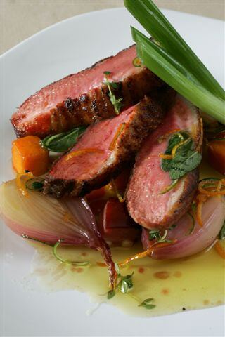 CRISPY DUCK BREAST, SAGE AND THYME GLAZED BUTTERNUT SQUASH AND SHALLOT AND CURED BACON WITH TOSSED ROCKET LEAVES