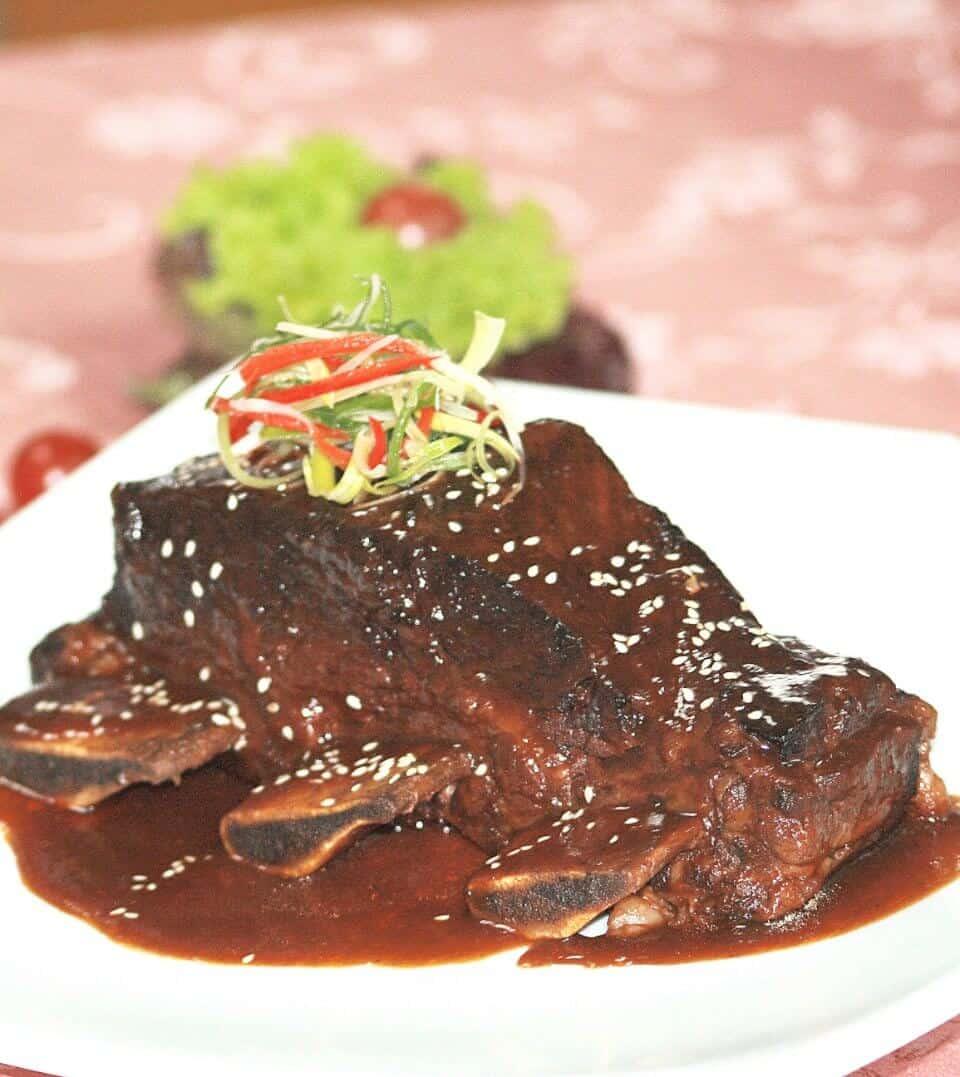 BRAISED BEEF RIBS IN SPICED ORANGE TAMARIND SAUCE