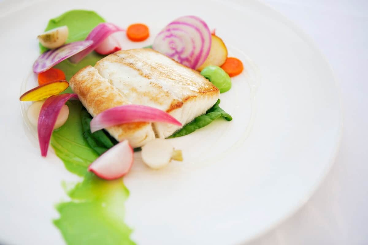 HALIBUT, HONEY SOUSED VEGETABLES, AVOCADO PURÉE, SORREL