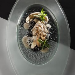 Abalone, Pan-Seared And Served With Squid-Ink Risotto