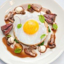 Duck Egg Tart with Red Wine Sauce, Turnip Puree, Lardons, Young Sorrel and Sautéed Duck Heart