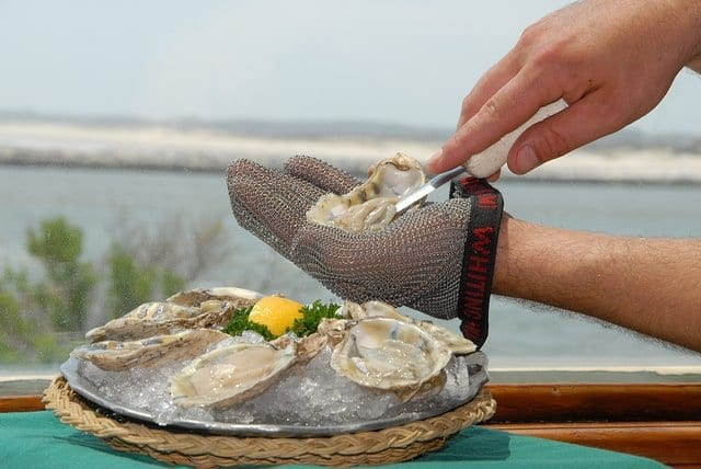 SHUCKING OYSTERS (FROM THE FRONT)