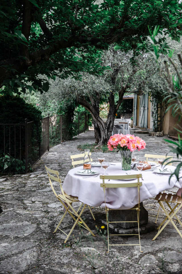 Enjoy lunch in the beautiful garden at Julia Child's house