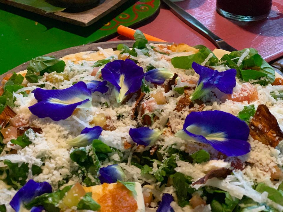 Pizza with edible flowers