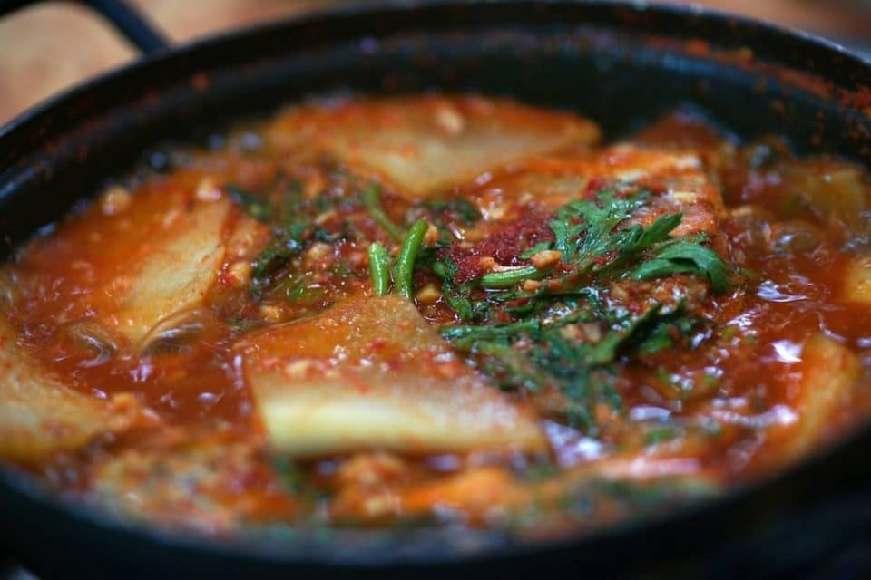 stew consisting of seasonal freshwater fish, radish, and suk-gat (edible chrysanthemum).
